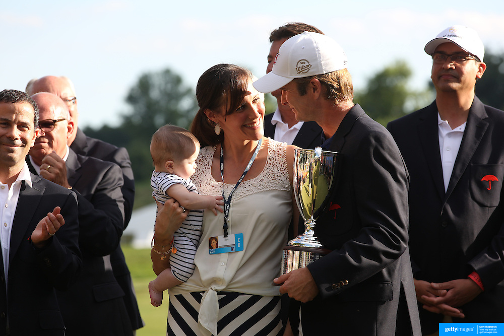 Kevin Streelman with his wife, Courtney, who is holding their 6-month-old daughter, Sophia, after winning the Travelers Championship at the TPC River Highlands, Cromwell, Connecticut, USA. 22nd June 2014. Photo Tim Clayton