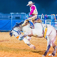 LOGANDALE , NEVADA - APRIL 10 : Cowboy Participating in a Bucking Horse Competition at the Clark County Fair and Rodeo a Professional Rodeo held in Logandale Nevada , USA on April 10 2015