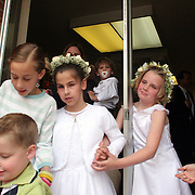 Annabelle Costanzo leaves the chapel after her first communion at Holy Trinity Church Sunday.  Costanzo, who has been blind since birth, will make a trip to Detroit in August to she specialist Michael Trese.  The family is hoping that a new techinique, using an endoscope will reveal more information about her retina, and eventually lead to a possible cornea transplant.  photo by david peterson