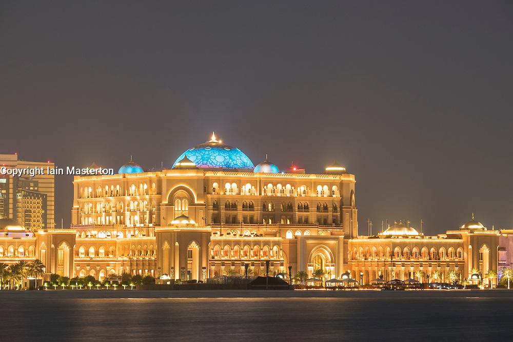 Exterior night view of luxury Emirates Palace Hotel in Abu Dhabi United Arab Emirates