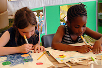 Children drawing in afternoon workshop at London