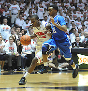 "Mississippi's Jarvis Summers (32) drives against Kentucky's Ryan Harrow (12) at the C.M. ""Tad"" Smith Coliseum on Tuesday, January 29, 2013. Kentucky won 87-74. (AP Photo/Oxford Eagle, Bruce Newman).."