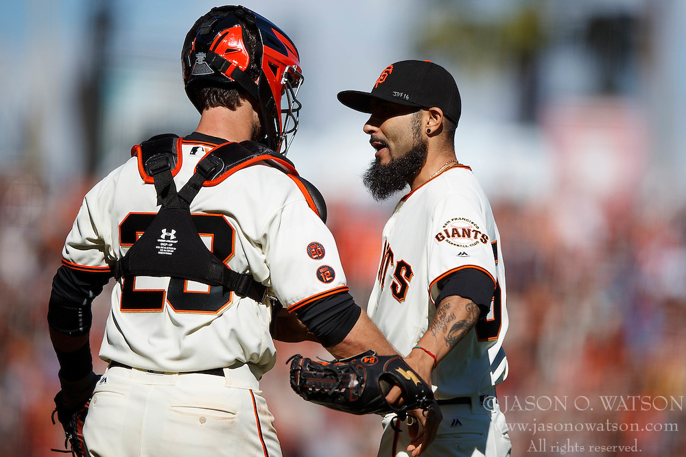 SAN FRANCISCO, CA - OCTOBER 02: Sergio Romo #54 of the San Francisco Giants celebrates with Buster Posey #28 after the game against the Los Angeles Dodgers at AT&T Park on October 2, 2016 in San Francisco, California. The San Francisco Giants defeated the Los Angeles Dodgers 7-1. (Photo by Jason O. Watson/Getty Images) *** Local Caption *** Sergio Romo; Buster Posey