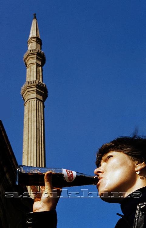 Woman drinking Sport Cola