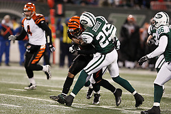 Jan 3, 2010; East Rutherford, NJ, USA; New York Jets safety Kerry Rhodes (25) makes a tackle during the second half at Giants Stadium. The Jets clinched a playoff spot with a 37-0 win over the Bengals.