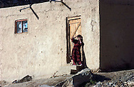 Residents make their way through the Old City  May 5, 2005 in Kabul, Afghanistan. The Afghan government is struggling to decide whether to modernize much of the destroyed or try to rebuild and preserve the architecture of traditional areas.<br /> Photo by Keith Bedford