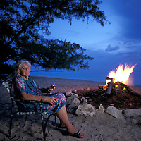 Ms. Armbrister at camp fire on the beach, Fernandez Bay Village, Cat Island,  Bahamas