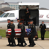 Joe Imel/Daily News.The flag-drapped casket of Sgt. Adam J. Kohlhaas, 26, of Bowling Green, is taken from a plane Tuesday at the Bowling Green/Warren County Airport.  Kohlhaas died April 21, 2008, in Bayji, Iraq.