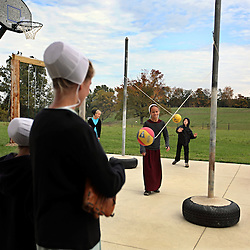 Amish children play at their school playground in Berlin, Ohio, Oct. 12, 2009.