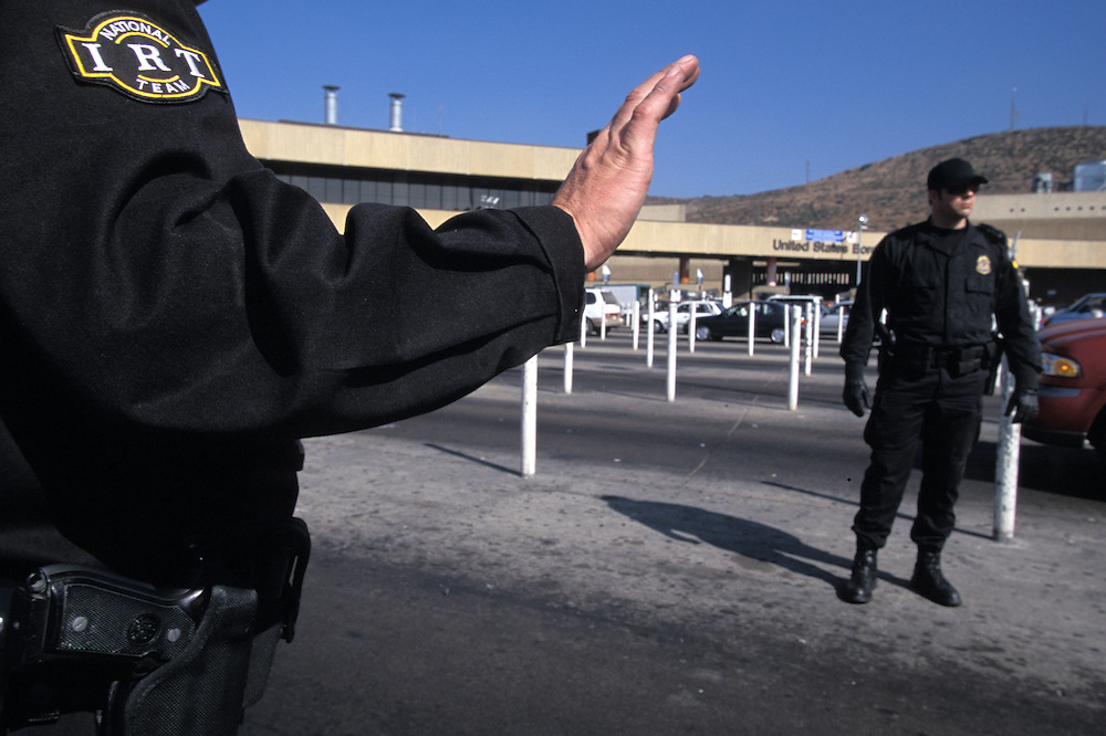 Members of the federal Immigration Response Team work to inspect vehicles before they cross into the United States at the San Ysidro Port of Entry in San Diego, California. Please contact Todd Bigelow directly with your licensing requests. PLEASE CONTACT TODD BIGELOW DIRECTLY WITH YOUR LICENSING REQUEST. THANK YOU!