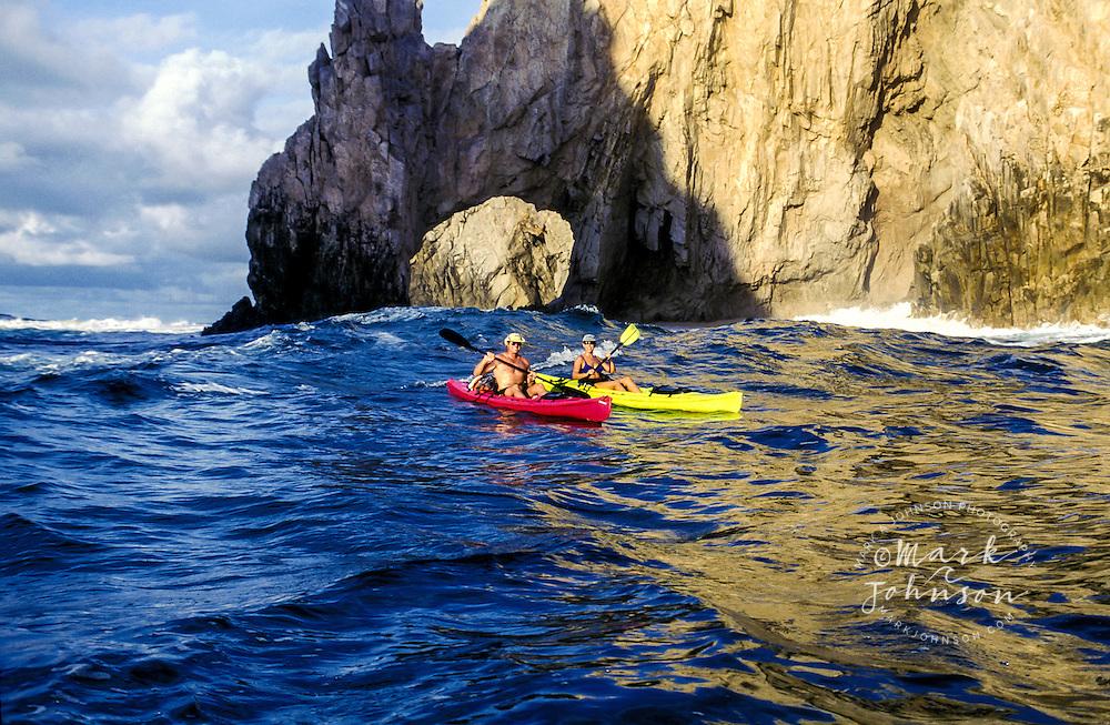 Mexico, Baja California, Cabo San Lucas, couple kayaking off The Arch.