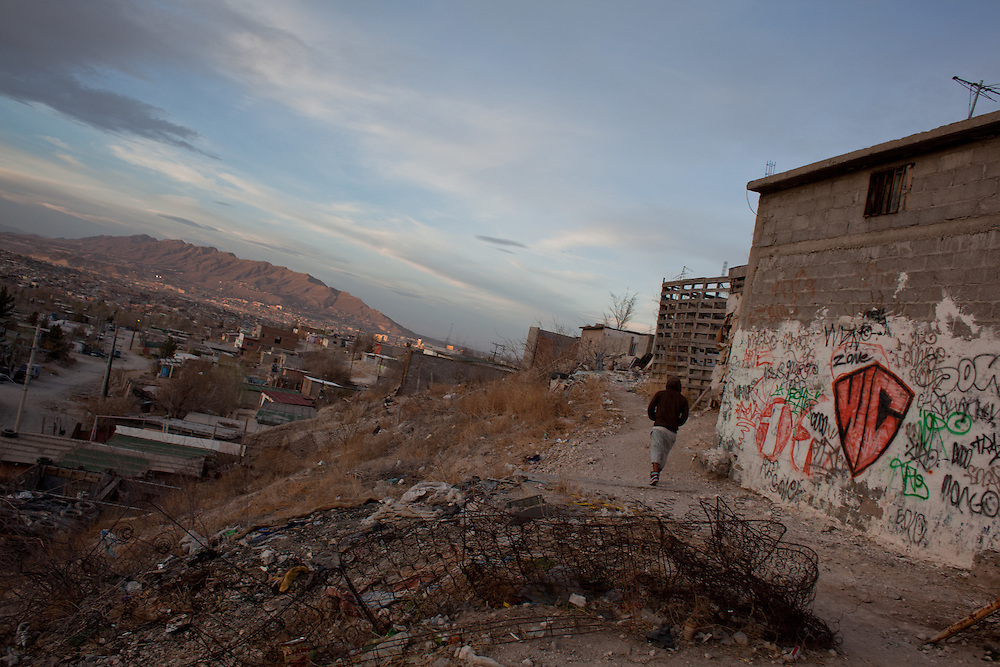 A youth is seen in the Diaz Ordaz colonia, one of the poorest neighborhoods of Ciudad Juarez. The group hangs out out a lookout above the neighborhood to see if outside gangs are coming to attack or rob them, after they had recieved death threats and a series of violent exchanges between neighborhoods left them nervous.
