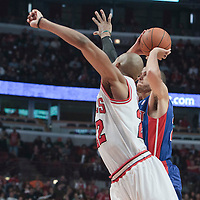 30 October 2010: Detroit Pistons Tayshaun Prince takes a jumpshot over Chicago Bulls Taj Gibson during the Chicago Bulls 101-91 victory over the Detroit Pistons at the United Center, in Chicago, Illinois, USA.