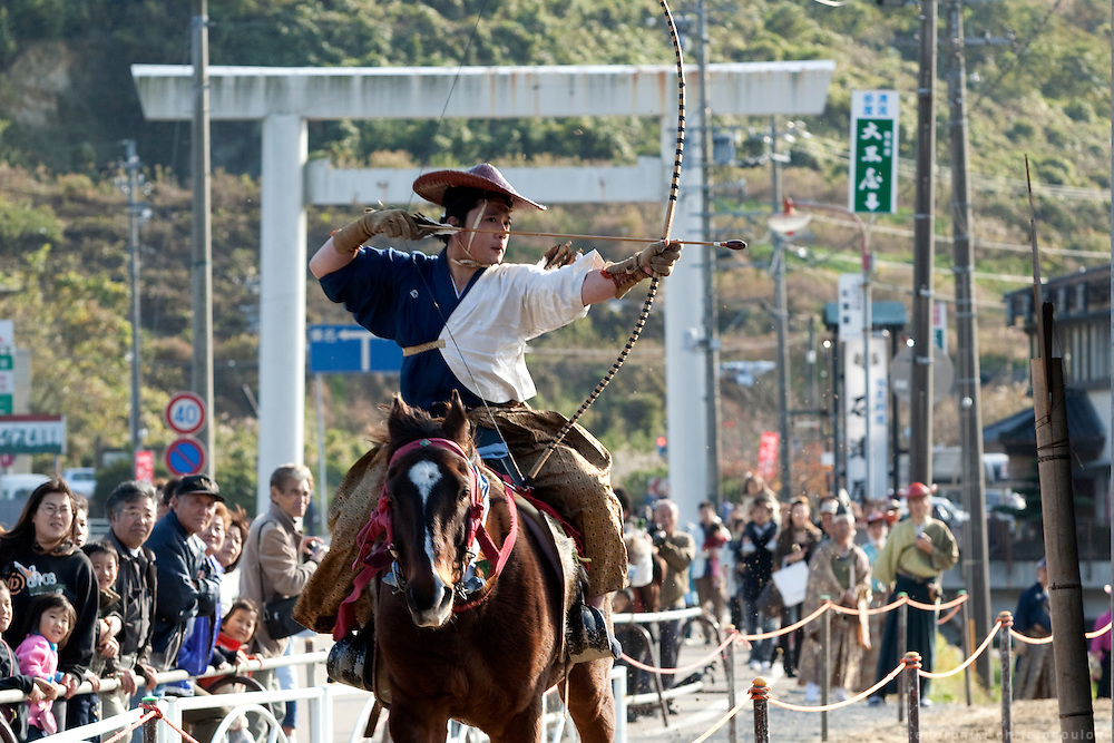 Archers shooting during the Yabusame ritual in Tado shrine.