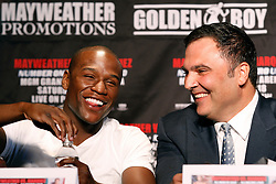 May 19, 2009; New York, NY, USA; Floyd Mayweather Jr. (l) and Golden Boy CEO Richard Schaefer laugh at the press conference announcing Mayweather's upcoming fight against Juan Manuel Marquez.  The two will meet on July 18, 2009 at the MGM Grand Garden Arena in Las Vegas, NV.