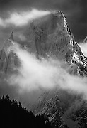 Storm clouds and wind on the north face of the Grand Charmoz, one of the most famous and picturesque peaks in the Massif of Mont Blanc, Chamonix Alps.
