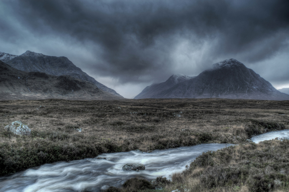 Glen Etive, Buachaille Etive Mor, and the River Etive, Glen Etive, Highlands, Scotland. Buachaille Etive Mor is a pyramid shaped mountain at the head of  Glen Etive in the Highlands of Scotland.  The highest peak of Buachaille Etive Mor is Stob Dearg at 1021 metres. The River Etive