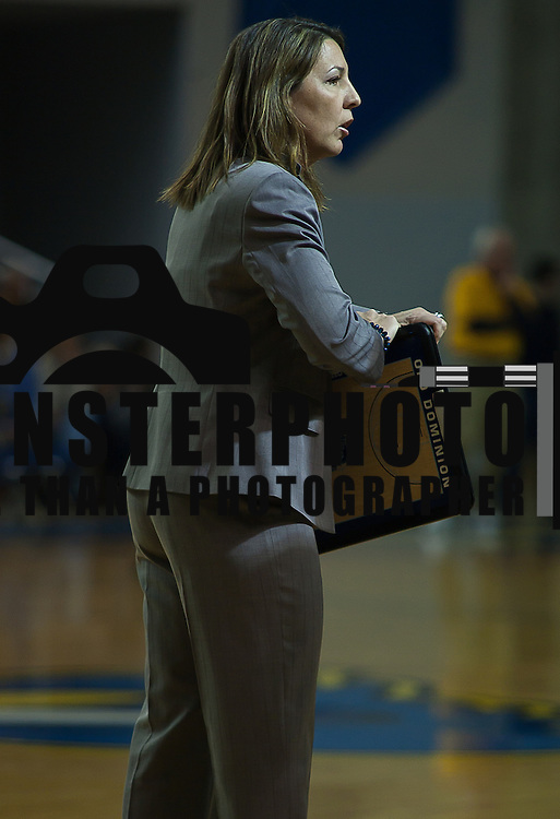 02/09/12 Newark DE: Lady Monarchs Head Coach Karen Barefoot prepares to enter the huddle during a time out of a Colonial Athletic Association game against Delaware, Feb. 9, 2012 at the Bob carpenter center in Newark Delaware.