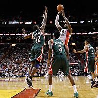 22 January 2012: Miami Heat small forward LeBron James (6) takes a jumpshot over Milwaukee Bucks small forward Luc Richard Mbah a Moute (12) during the Milwaukee Bucks 91-82 victory over the Miami Heat at the AmericanAirlines Arena, Miami, Florida, USA.