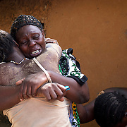 Women embrace in grief after an attack in Kibusu village at Tana Delta region of the Kenyan Coast.