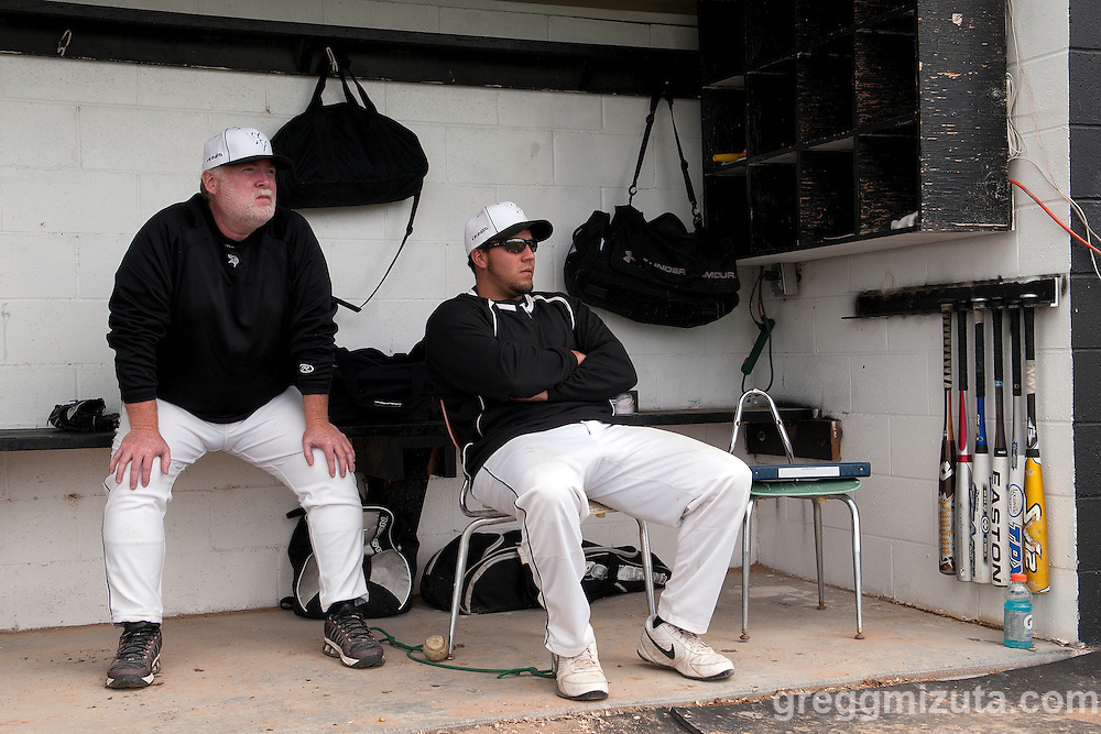 Vale Viking coaches Rick Bates and Garrett Brown watch infield practice before the start of the 3A Oregon State Championship quarterfinals game against Dayton on May 27, 2011 at Cammann Field, Vale, Oregon.