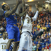 Delaware Guard Devon Saddler (10) drives to the basket as Drexel Forward Mohamed Bah (15) defends in the first half of a NCAA regular season Colonial Athletic Association conference game between Delaware and Drexel Sunday, Feb 23, 2014 at The Bob Carpenter Sports Convocation Center in Newark Delaware.