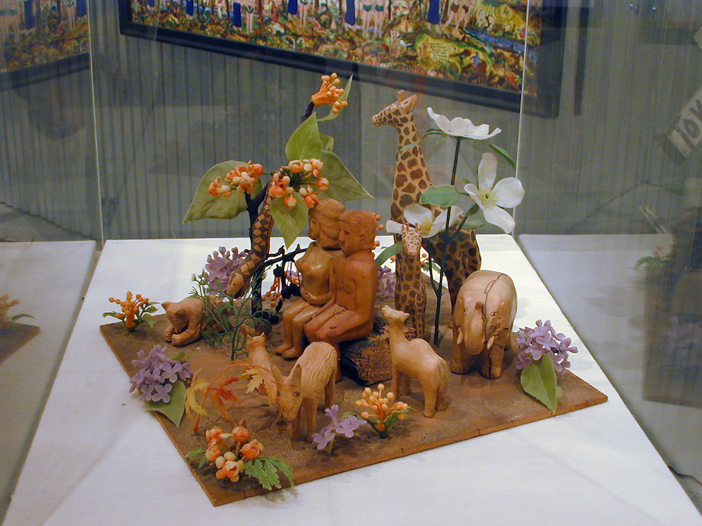 Lawrence Stinson (1906-1998)<br /> &quot;Garden of Eden,&quot; 1975<br /> Plywood, driftwood, plastic flowers and paint, 9.5 x 13 x 14<br /> Collection of Chuck and Jan Rosenak