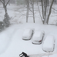 (Boston, MA - 2/15/15) A man uses a snow blower to clear a parking lot in Boston, Sunday, February 15, 2015. Staff photo by Angela Rowlings.