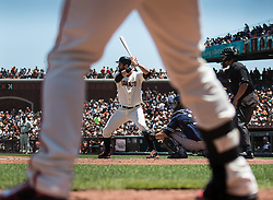 Brandon Belt (Batting), Brandon Crawford (legs) on the on-deck circle, 2015.