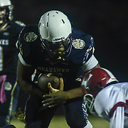 Delaware Military Academy running back Todd Turner (4) rushes for extra yardage during a Week 8 DIAA football game between Laurel and Delaware Military Academy Saturday, Oct. 29, 2016, at Baynard Stadium in Wilmington.