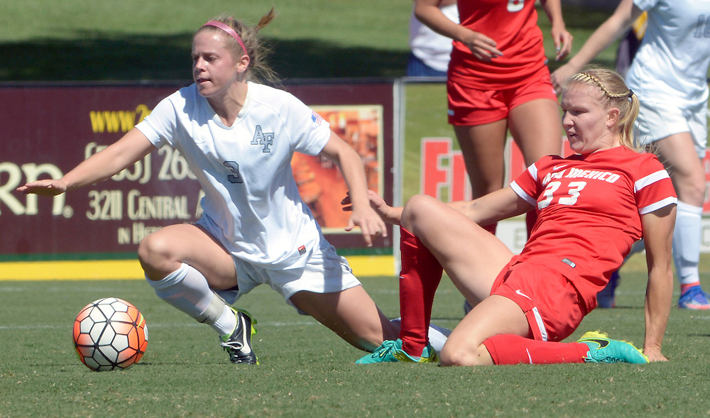 gbs092516v/SPORTS -- Air Force's Alison Skidmor, left, and UNM's Jessie Hix  slide for the ball during the game at the UNM Soccer Complex on Sunday, September 25, 2016. Air Force won 2-1.(Greg Sorber/Albuquerque Journal)