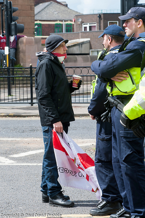 EDL supporter chats to police officers after the EDL rally held in All Saints Square near Rotherham Minster, Rotherham South Yorkshire<br /> <br /> May 10 2014<br /> Image &copy; Paul David Drabble <br /> www.pauldaviddrabble.co.uk
