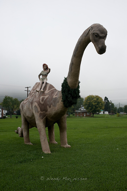A statue of a woman on a dinosaur stands as a sign for the local wax-museum close to the Natural Bridge along the Blue Ridge Parkway. Virginia, USA, 2011