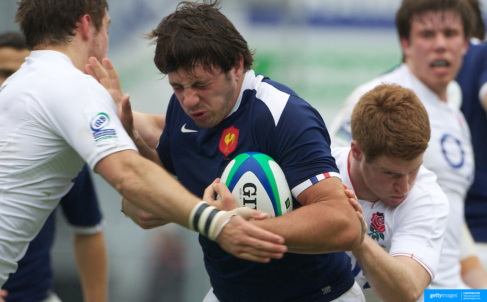 Remi Lamerat, France, is tackled during the England V France group stage match at Estadio El Coloso del Parque, Rosario, Argentina, during the IRB Junior World Championships. 13th June 2010. Photo Tim Clayton....