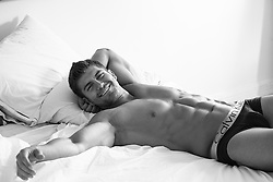sexy man in briefs at home in bed