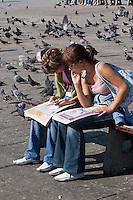 Girls reading their newspapers in Rynek Glowny, Krakow