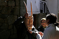 """A man puts on a wooden mask during the traditional Celtic carnival """"Caretos"""" in the village of Lazarim, central Portugal on February 17, 2015. PAULO CUNHA /4SEE"""