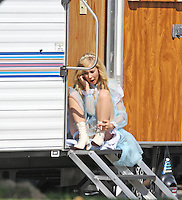 "April 14th, 2010 Los Angeles, CA. ***Exclusive*** Milla Jovovich and William H. Macy are the bride and groom as they prepare to film a wedding scene together for ""Bad Girl"" starring British actress Juno Temple who was seen hanging out by her trailer. Macy was spotted brushing his teeth before going to set and kissing Jovovich in the wedding scene. Macy was also seen playing a miniture guitar during filming breaks. Photo by Eric Ford/ On Location News. 818-613-3955. info@onlocationnews.com"