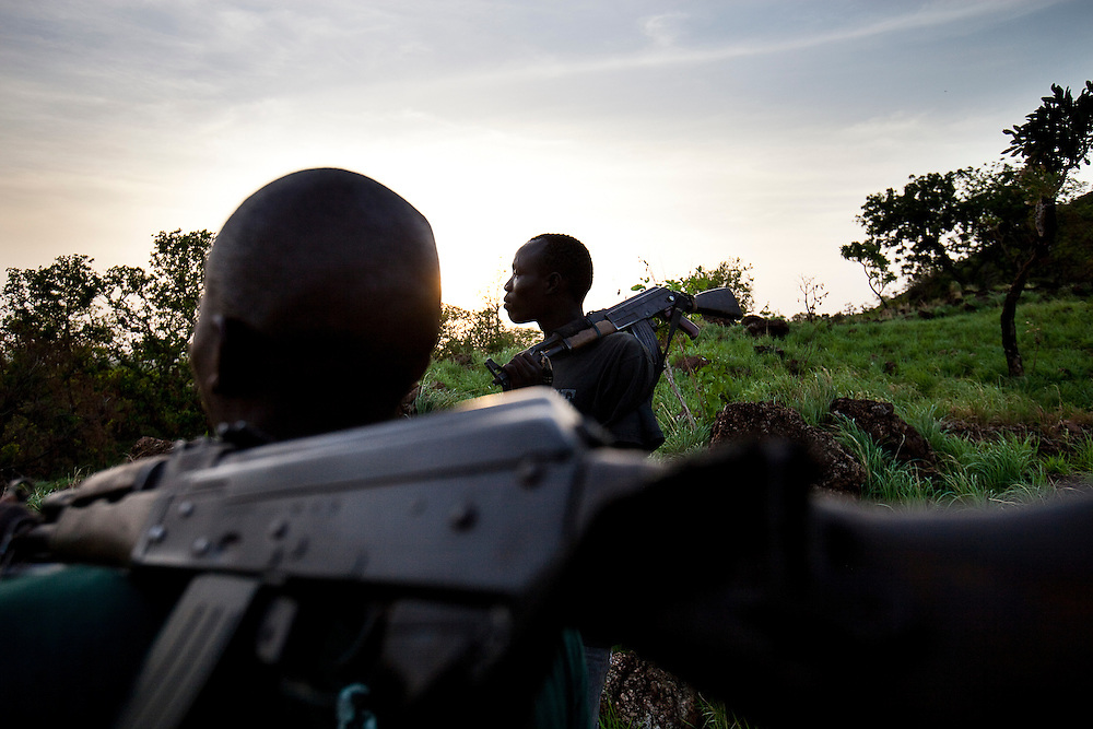 Murle warriors patrol their village during a dispute with a neighboring tribe.