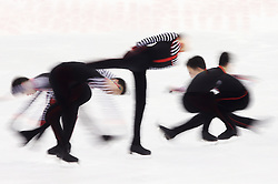 A multiple exposure picture of Nam Nguyen of Canada performing during the Men free skating program at the ISU World Figure Skating Championships at Shanghai Oriental Sports Center in Shanghai, China, 28 March 2015.