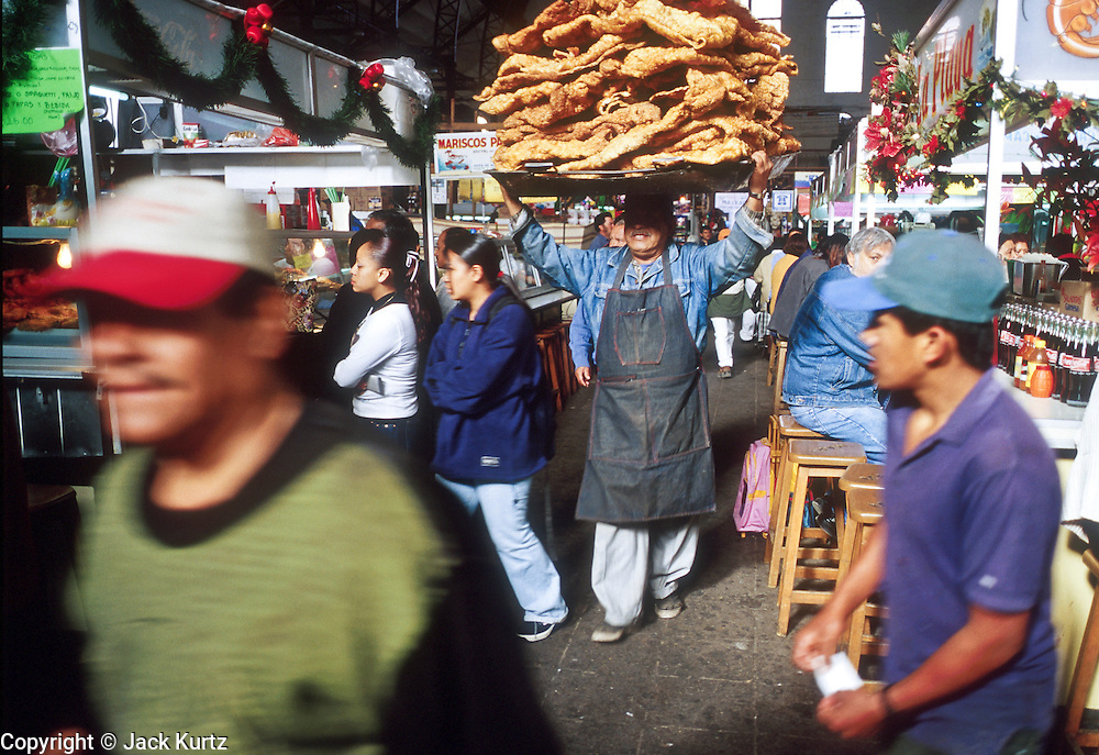 16 JANUARY 2002, GUANAJUATO, GUANAJUATO, MEXICO: A chicharone (fried pork skins) vendor walks through the market in the city of Gunajuato, state of Guanajuato, Mexico, Jan. 16, 2002. PHOTO BY JACK KURTZ
