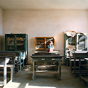 Pupil in the elementary school of Kalivia. There are 11 abandoned classrooms in the school, the twelfth serves the school.