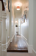 Corridor to bathroom from a contemporary refurbishment of a Victorian terrace house at 74 Ulverscroft Road, East Dulwich, London, England. Designed by Jo Houchell & architect Oliver Houchell, 2008