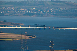 The Clackmannanshire Bridge road bridge over the Firth of Forth. with the swinging central section of Kincardine Bridge behind. View from the slope of the Dumyat, a hill at the western extremity of the Ochil Hills, in central Scotland..Pic © Michael Schofield...