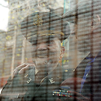 (Boston, MA - 5/1/16) Ret. Army Col. Cranston Rogers, who was one of the soldiers who liberated the Dachau concentration camp, talks with Dachau survivor Stephen Ross during the community Holocaust commemoration of Yom Hashoah at the New England Holocaust Memorial, Sunday,  May 01, 2016. They are seen behind a glass panel etched with the identification numbers of concentration camp victims. Staff photo by Angela Rowlings.