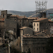 Metal frames keep hold of what is left of the iconic medieval tower that once characterized the skyline of Santo Stefano di Sessanio as works are in progress to reconstruct it after it collapsed in the 2009 earthquake, Santo Stefano di Sessanio in in the province of L'Aquila in Abruzzo.