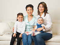 Portrait of mother with daughter and two granddaughters.