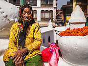 07 MARCH 2017 - KATHMANDU, NEPAL: A Nepalese Buddhist woman at the consecration ceremony at Boudhanath Stupa. Boudhanath Stupa, the most important Buddhist site in Nepal and a popular tourist attraction, was consecrated Tuesday in a ceremony attended by thousands of Buddhist monks and Buddhist people from Nepal and Tibet. The stupa was badly damaged in the 2015 earthquake that devastated Nepal. The stupa, which reopened in November 2016, was repaired in about 18 months. The repair was financed by private donations raised by international Buddhist organizations.     PHOTO BY JACK KURTZ