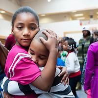 A hug at the Goodwill Holiday Party at Goodwill headquarters in Roxbury.