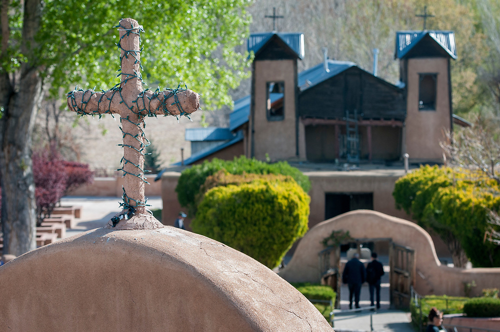 em041317g/jnorth/Hundreds of people visited the Santuario de Chimayo Thursday April 13, 2017. Thousands will make their Easter pilgrimage on Good Friday to the Northern New mexico Church. (Eddie Moore/Albuquerque Journal